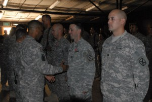 *Photo, right most, Captain Steven Lim's about to receive an award at HHC Award Ceremony, July 14, 2010, FOB Hammer, Iraq, 15 days after Manning is arrestedFrom 2nd Brigade Combat Team, 10th Mountain Division Facebook Profile